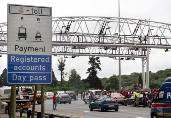 Anti e-tolling protestors are seen demonstrating under an e-toll gantry on the N1 South, 6 December 2012, during a drive slow protest. Picture: Refilwe Modise