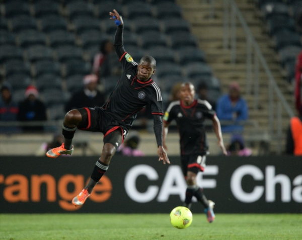 Sifido Myeni of Pirates wins the ball during the CAF Champions League match between Orlando Pirates and AC Leopards from Soweto Stadium on July 20, 2013 in Soweto, South Africa. (Photo by Duif du Toit/Gallo Images)