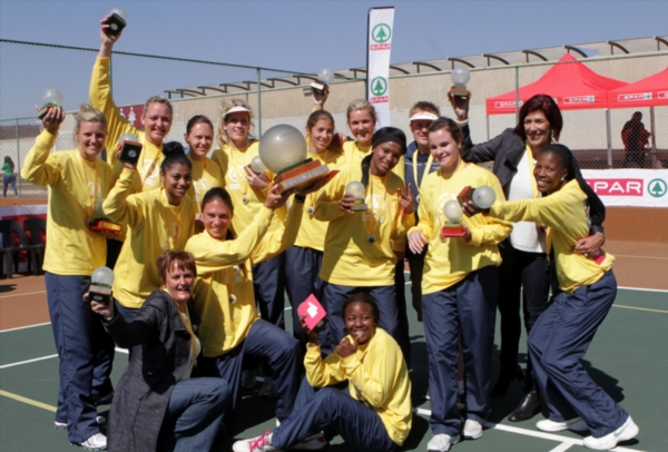 The winning Mangaung Metro team. (L-R) Back: Maryka Holtzhausen, Mari-Lise Linde, Carine Terblanche, Karla Mostert, Iselma Parkin, Zi-Mari Smit, Michael Shaw (Trainer) and Burta de Kock (Coach). Middle: Lauren-Lee Christians, Adelle Niemand (Captain), Sheherezide Duimpies, Ane Botha and Success Lekaba. Front: Corne Marais (Manager) and Dakalo Tshikala. Mangaung Metro beat Gauteng North in the final during day 6 of the SPAR National Netball Championships at the Royal Bafokeng Sports Palace on August 10, 2013 in Rustenburg, South Africa. (Photo by Reg Caldecott/Gallo Images)