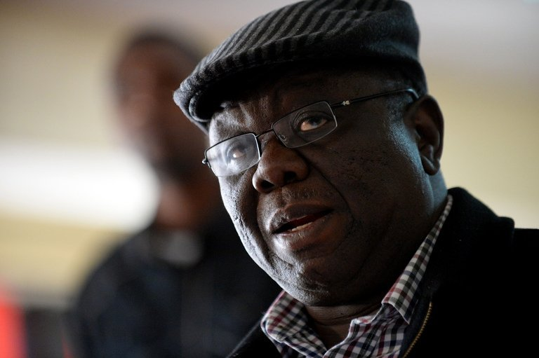 """Zimbabwe presidential hopeful Morgan Tsvangirai speaks in Harare on August 1, 2013. Tsvangirai described the election as a """"huge farce"""" just hours after Robert Mugabe's allies claimed victory, and warned the country faced a serious crisis."""
