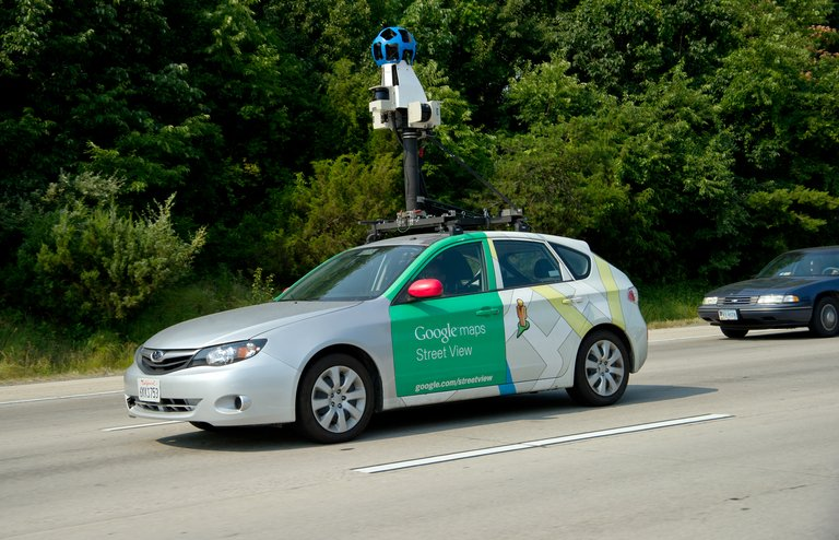 """This June 28, 2012 photo shows a Google Street View vehicle as it collects imagery while driving down Interstate I-66 near Centreville, Virginia. Thai villagers on Wednesday apologised for mistaking a Google worker for a government snoop as he carried out mapping for the Internet giant's """"Street View"""" programme in a remote area."""