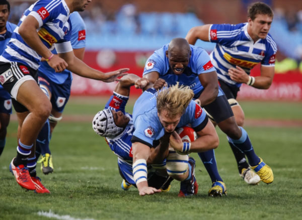 PRETORIA, SOUTH AFRICA - SEPTEMBER 14: Jacques du Plessis of the Bulls and Bongi Mbonambi drive for the Bulls with Nizaam Carr tackling for WP during the Absa Currie Cup match between Vodacom Blue Bulls and DHL Western Province from Loftus Versfeld on September 14, 2013 in Pretoria, South Africa. (Photo by Dominic Barnardt/Gallo Images)