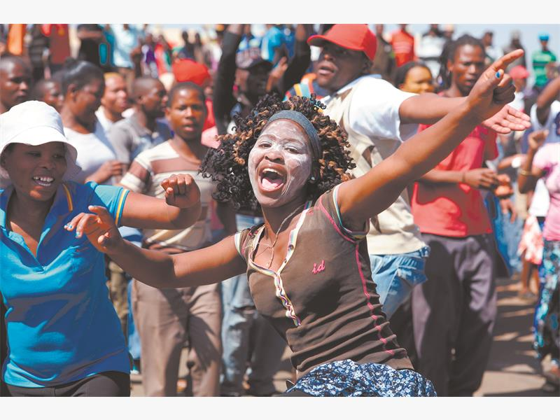 'MAYOR MUST GO'. Bekkersdal residents take to the streets during a service delivery protest yesterday. They demanded the local district mayor resign, accusing her of corruption. Picture: Refilwe Modise.
