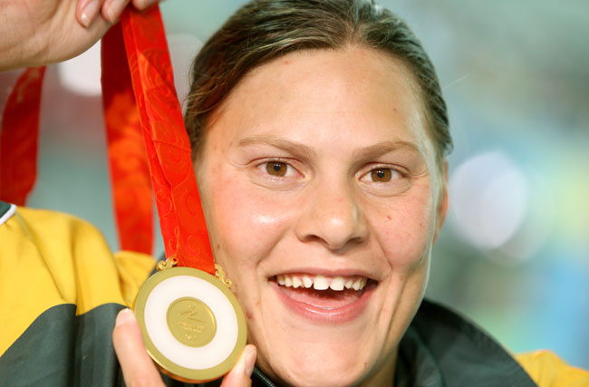 South African swimmer Natalie Du Toit smiles with her gold medal over 50m Freestyle at the Beijing 2008 Paralympic Games in Beijing, China, 14 September 2008. Du Toit has conquered five gold medals overall. Photo: ROLF VENNENBERND