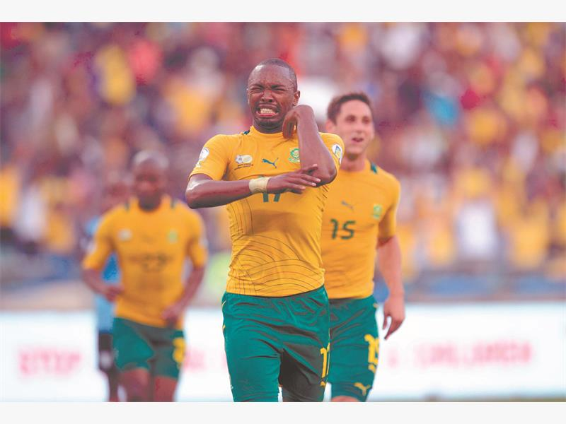 TIME TO CELEBRATE. Bafana striker Bernard Parker celebrates scoring one of his two goals in their 2014 World Cup qualifier against Botswana at the Moses Mabhida Stadium in Durban on Saturday. Bafana won 4-1 but failed to qualify. Picture: Backpagepix.