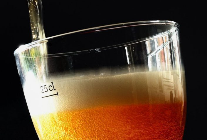 Beer is poured into a glass. Image AFP