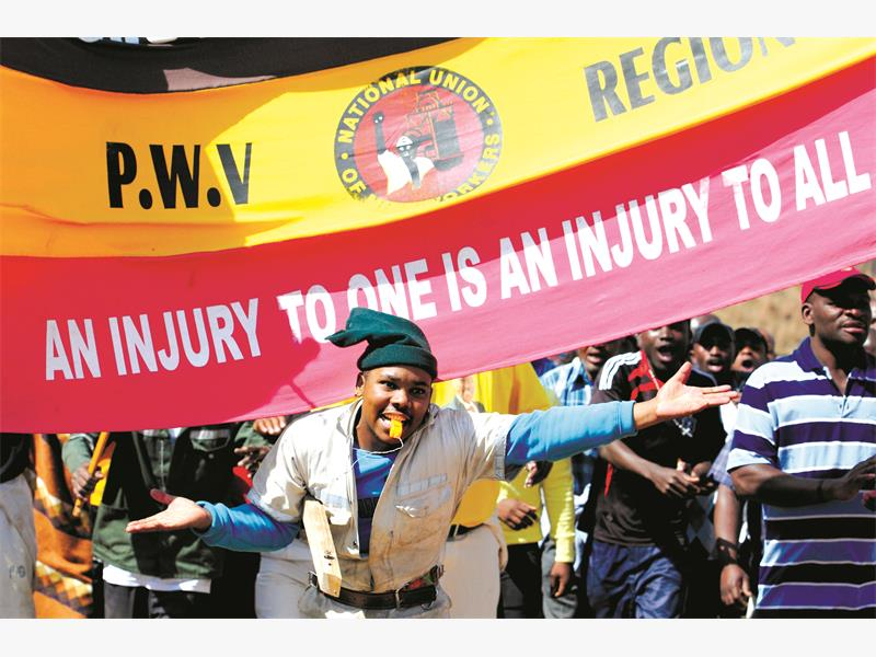 Members of NUM march to the Gold Fields offices in Carltonville during a wage strike. Picture: Refilwe Modise.