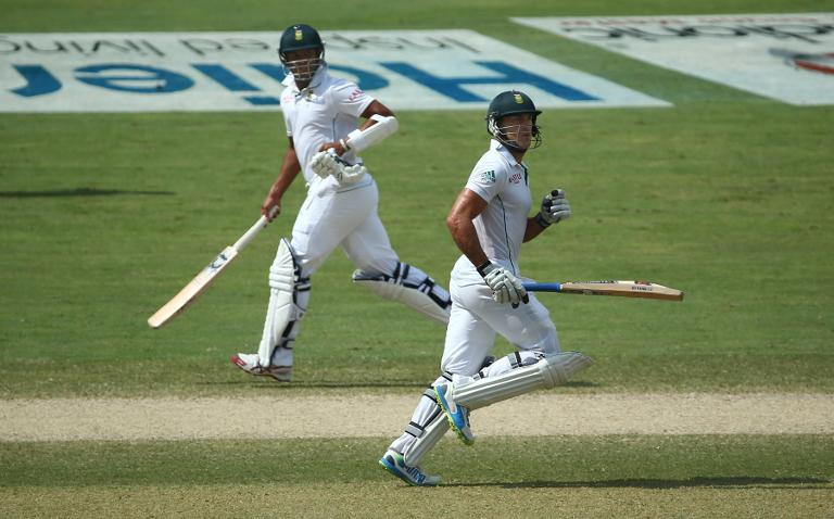 South Africa batsmen Faf Du Plessis (R) and Vernon Philander run between wickets on the third day of the second Test in Dubai on October 25, 2013