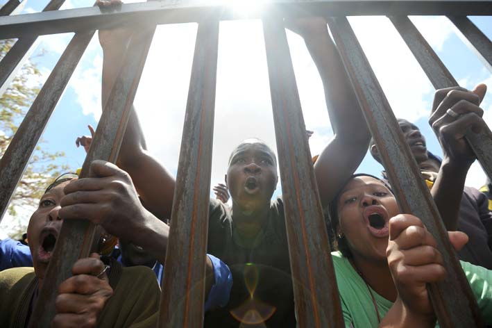 FILE PICTURE: Protesters carry a gate. Picture: Refilwe Modise