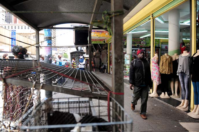 FILE PIC. A man walks past empty stalls that used to be occupied by  traders. Picture: Tracy lee Stark