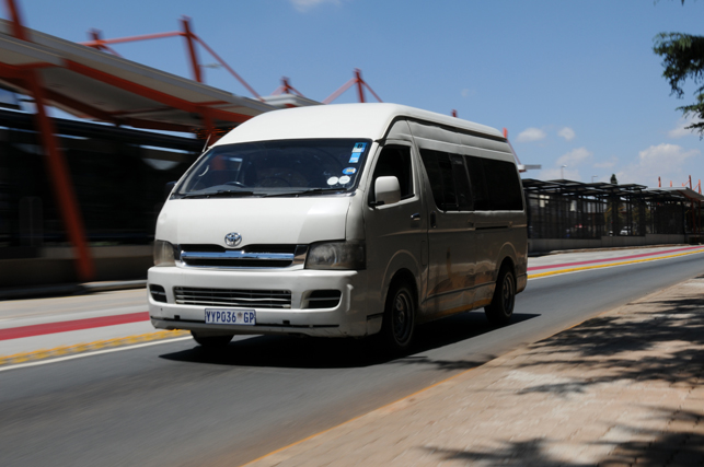 FILE PIC. A taxi seen driving past the Rea Vaya bus stop, 04 November 2013, Industria west, Johannesburg. Picture: Alaister Russell