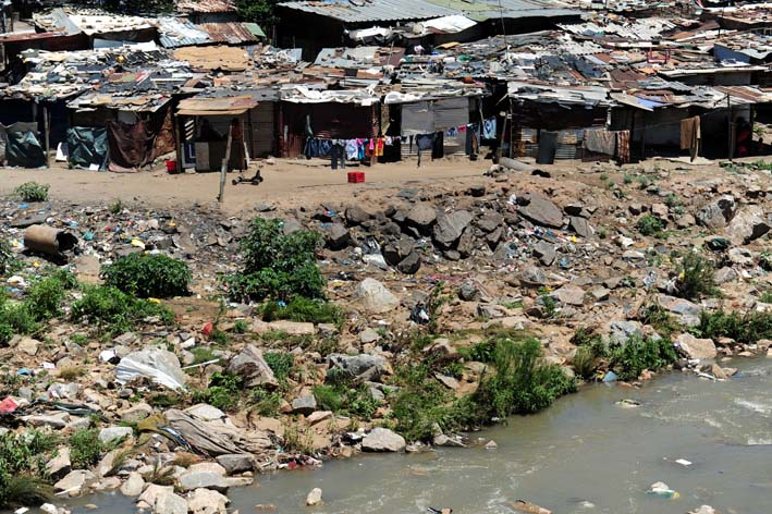 FILE PICTURE: Shacks are seen on the Jukskei River in Alexandra, northern Johannesburg: Tracy Lee Stark