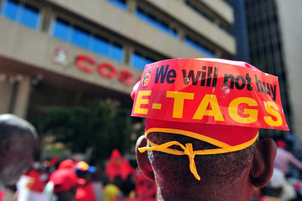 FILE PICTURE: Cosatu members marched in protest against amonst other things e-tolls from Cosatu house in Braamfontein to various key points in the city, 14 November 2013. Picture: Neil McCartney