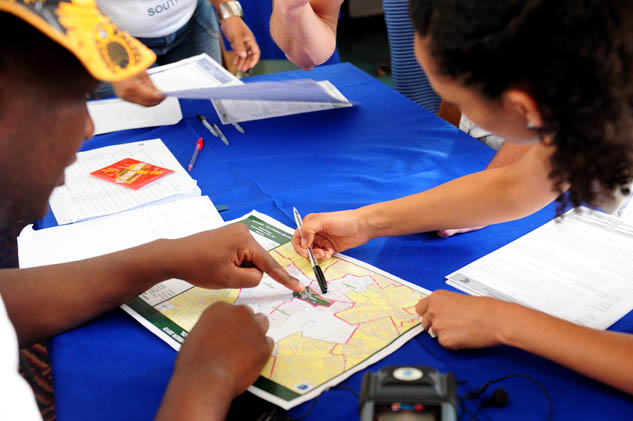 FILE PIC: IEC officials help people determine their voting districts. Picture: Tracy Lee Stark