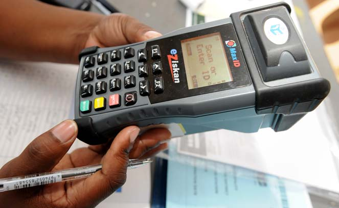 FILE PICTURE: IEC machine which scans an ID cards at Bosmont Recreation Centre in Johannesburg, 9 November 2013 during voter registration. Picture: Nigel Sibanda