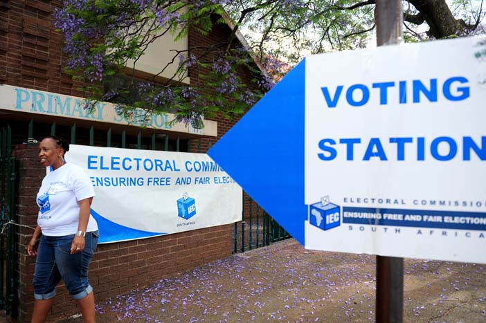 FILE PICTURE: An IEC official walks into a voter registration center. Picture: Tracy Lee Stark