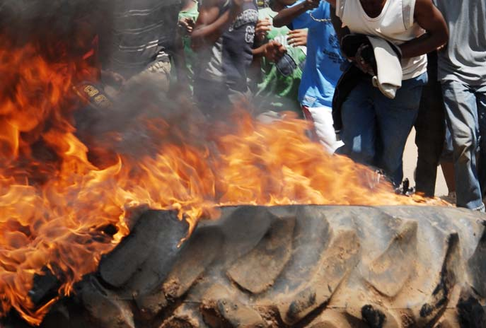 FILE PICTURE: Residents burn tyres during a protest.  Picture: Michel Bega