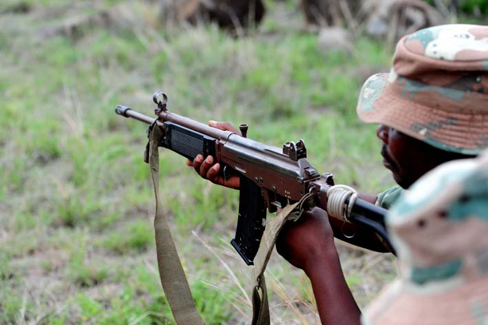 A member of the SANDF is seen in the Kruger National Park during a training operation against Rhino poaching, Picture: Tracy Lee Stark