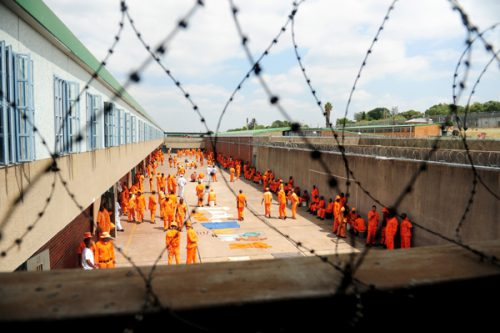 Inmates are seen inside a prison courtyard. Picture: Tracy Lee Stark