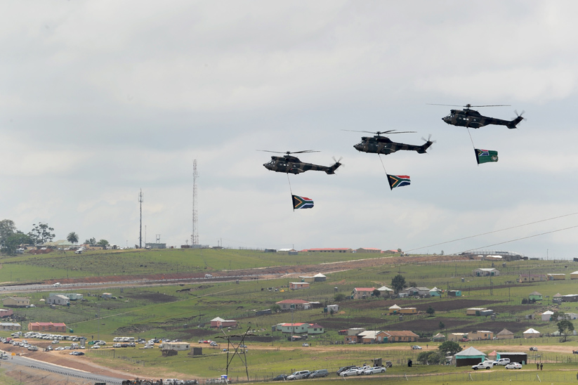 FILE PICTURE: Military helicopters flyover Qunu carrying South African flags during Nelson Mandela's funeral, 15 December 2013. Picture: Refilwe Modise
