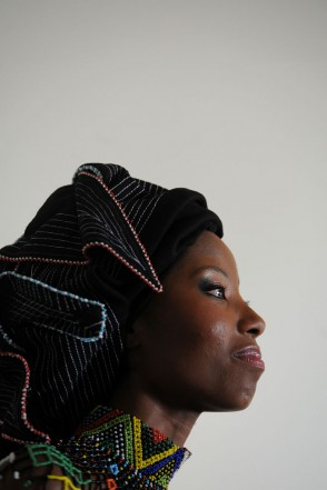 Miss Earth South Africa Ashanti Mbanga looks on during her offical send off in Hyde Park, 06 November 2013. Ashanti will be representing South Africa at the International Miss Earth finals in South East Asia and the head scarf she is wearing is part of her traditional outfit for the pageant.  Picture: Refilwe Modise