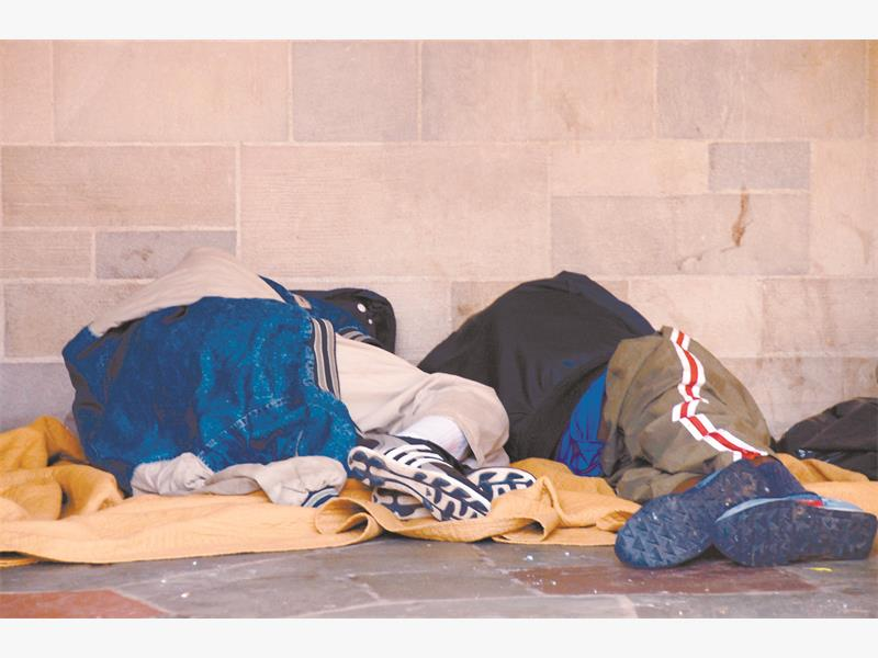 NOWHERE TO GO. Two homeless men forced to take refuge and sleep on the side of the road. Pictures: Stock.xchang.