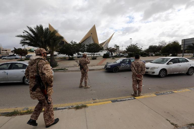 Soldiers from the Libyan army man a checkpoint in the capital Tripoli on January 26, 2014