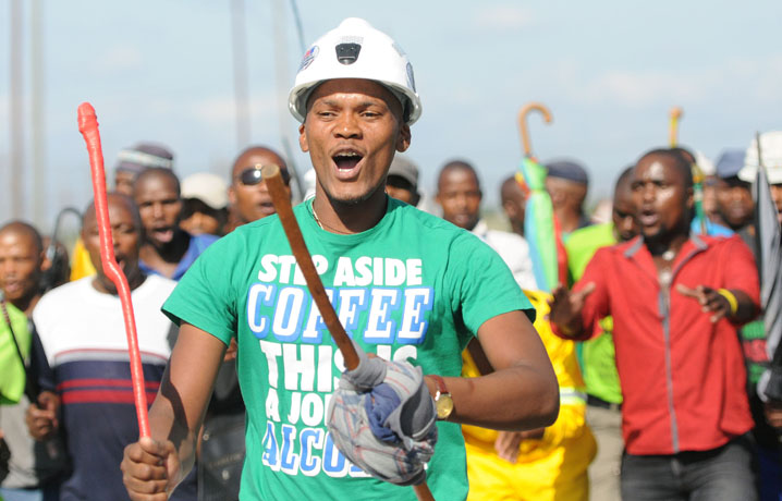 FILE PICTURE: A group of mine workers chants slogans next to Lomin mine in Marikana outside Rustenburg, 23 January 2013, next to Wonderkop stadium where AMCU union members  are meeting after downing their tools demanding an increase of R12 500 a month. Picture: Nigel Sibanda