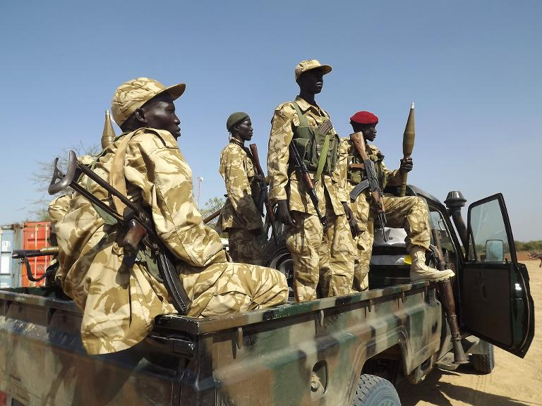 South Sudan army (SPLA) soldiers guard Bor airport on December 25, 2013