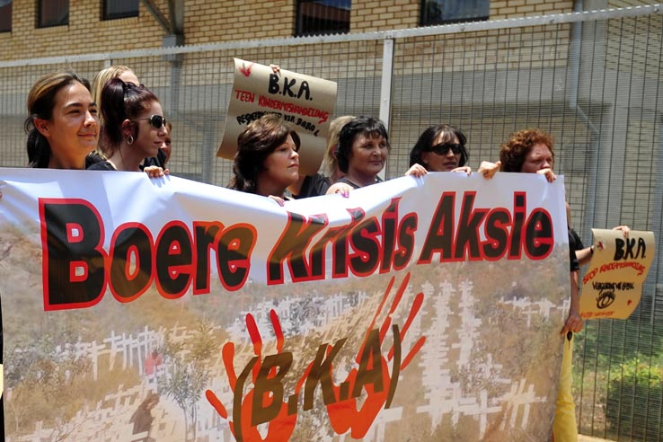 FILE PICTURE: Members of BKA outside the Pretoria North Regional Court on 14 January 2014  where a couple stands accused of abusing their two year old child. The case was postponed until Friday. Picture: Christine Vermooten