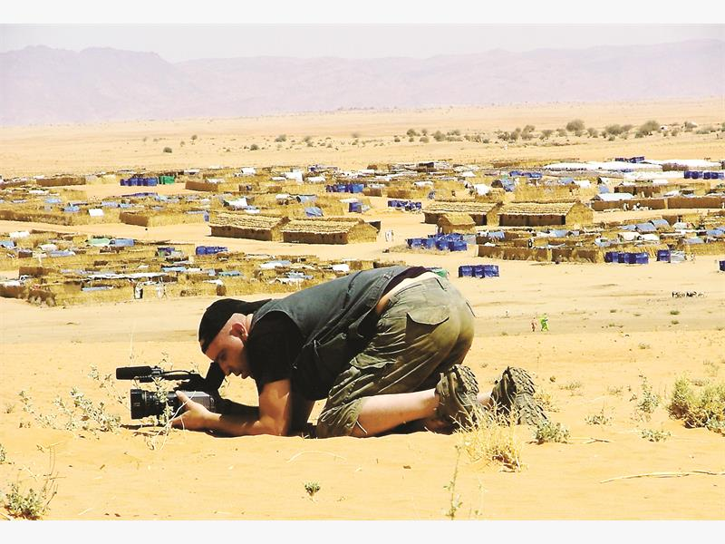 Dudley Saunders, photographed in 2006 in Darfur, in Sudan. Veteran cameraman Saunders was killed when he was hit by a train while filming in Soweto on Monday, 30 December 2013. Picture: Karin d'Orville
