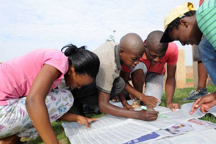 ( From L) Kgamogelo Lefakane, Happy Mbuyane, Samkelo Dlamini and malome Dlamini check for their results  outside their home at Bekkersdaal, West of Johannesburg, 7 January 2013. Picture: Nigel Sibanda
