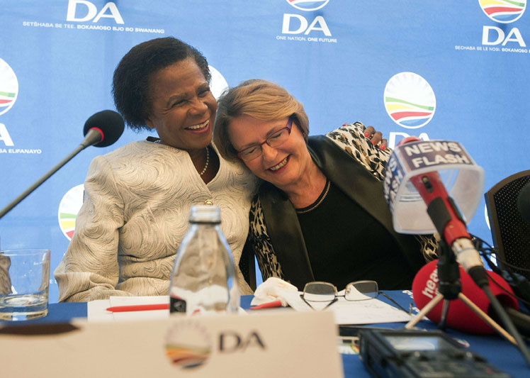 FILE PICTURE: Helen Zille (R), leader of the Democratic Alliance, is hugged by Mamphela Ramphele. AFP PHOTO