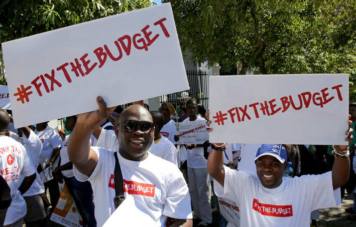 FILE PICTURE: Activists demonstrate in front of Parliament in Cape Town on Tuesday, 25 February 2014 ahead of the budget address to be delivered by Finance Minister Pravin Gordhan tomorrow. Picture: Nardus Engelbrecht/SAPA