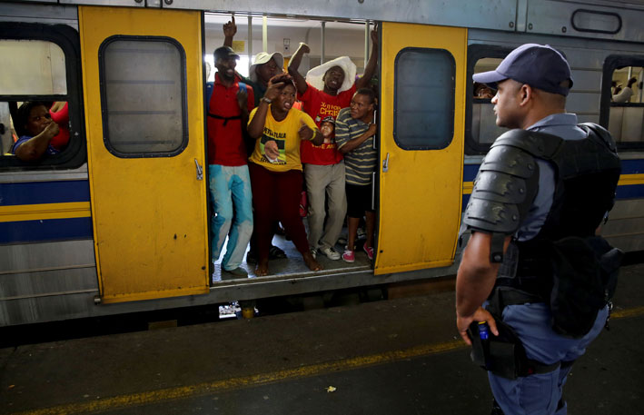 FILE PICTURE: Police force participants in an illegal march against poor service delivery on to a train. Picture: Nardus Engelbrecht/SAPA