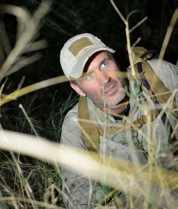 Joel Lambert hides from his pursuers in his new show 'Manhunt'