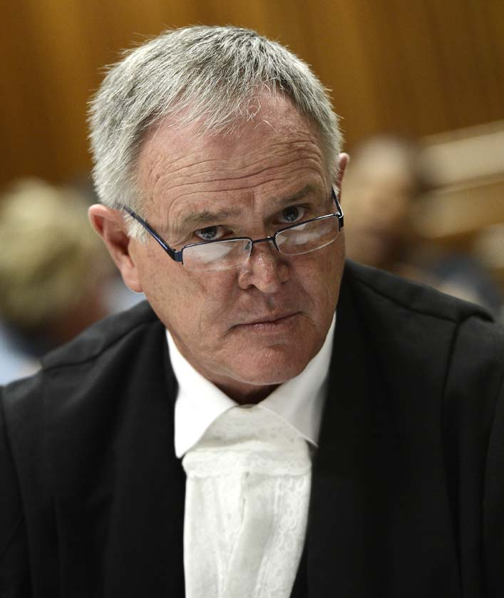 FILE PHOTO: Defence attorney Barry Roux attends on March 28, 2013 the bail application appeal of his client, South African Olympic sprinter Oscar Pistorius,  at the North Gauteng Hight Court in Pretoria.  AFP PHOTO / STEPHANE DE SAKUTIN