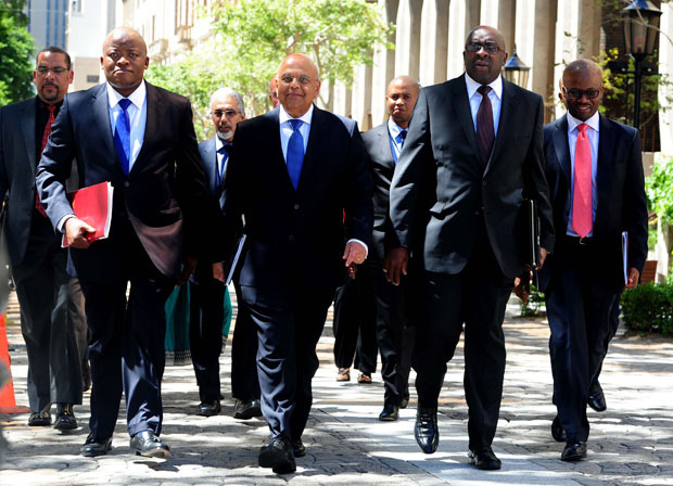 Former Finance Minister Pravin Gordhan flanked by Director-General Lungisa Fuzile and former Deputy Minister Nhlanhla Nene arrive in Parliament ahead of the 2014 Budget Speech. (Photo: GCIS)