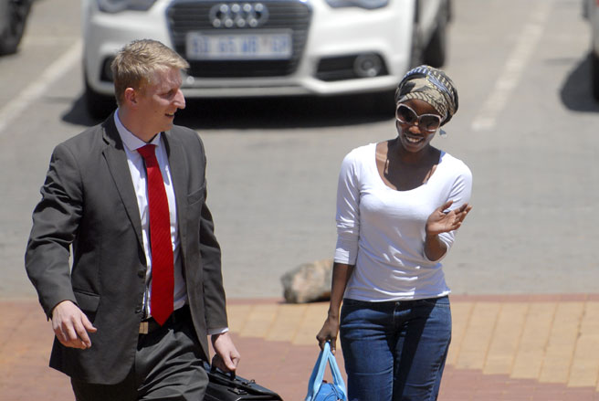 FILE PICTURE: Generations actress Maggie Benedict, also known as Akhona arrives with her lawyer, Jonathan Kaiser at the Randburg Magistrate's Court, 13 February 2014. The case was postponed. Picture: Tracy Lee Stark