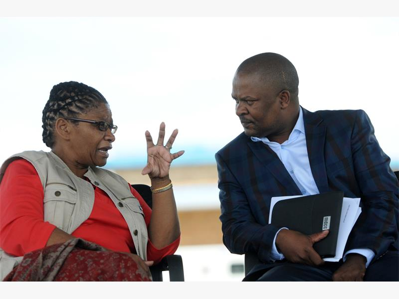 TALK TO THE HAND. North  West Premier Thandi Modise with MEC for Finance Paul Sebegoe at Brits Sports grounds in North West yesterday,  before addressing Madibeng residents. Picture: Nigel Sibanda.
