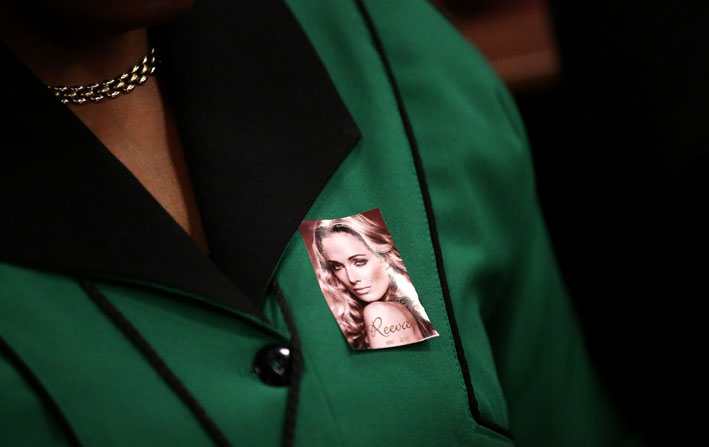 A member of the African National Congress Womens League wears a picture with the face of the late Reeva Steenkamp while attending Olympic and Paralympic track star Oscar Pistorius' murder trial at the North Gauteng High Court in Pretoria, Wednesday, 5 March 2014. Pistorius is on trial for murdering his girlfriend Reeva Steenkamp at his suburban Pretoria home on Valentine's Day last year. He says he mistook her for an intruder. Picture: Siphiwe Sibeko/Pool