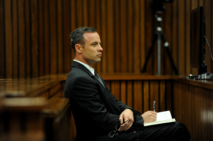 FILE PICTURE: Paralympic athlete Oscar Pistorius is seen during his ongoing trial for the murder of his girlfriend Reeva Steenkamp at Pretoria's North Gauteng High Court, Tuesday, 18 March 2014. Pistorius has pleaded not guilty to premeditated murder, contending that he shot the blonde swimsuit model through a locked bathroom door in his Pretoria home in the belief that an intruder was hiding behind it.The State is arguing that he killed her after the couple had a row.In addition to murder, the State has also charged Pistorius with contraventions of the Firearms Control Act. Picture:Werner Beukes/SAPA/Pool