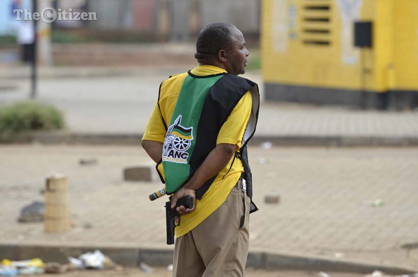 FILE PICTURE: An ANC member seen after drawing his gun to disperse residents, 13 March 2014, in Bekkersdal, Westonaria. Residents protested by blockading streets and pelting police cars over an election campaign planned by the ANC. Picture: Alaister Russell