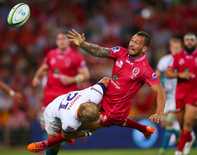 FILE PICTURE: Queensland Reds' fly-half Quade Cooper is tackled by Cheetahs scrum-half Sarel Pretorius during their Super 15 rugby union match at Suncorp Stadium in Brisbane, on March 7, 2014. Picture: Gallo images