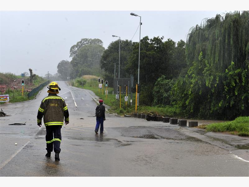 HELP. Tshwane Emergency Services ensures a pedestrian gets across a flooded street in Centurion yesterday. Picture: Christine Vermooten.