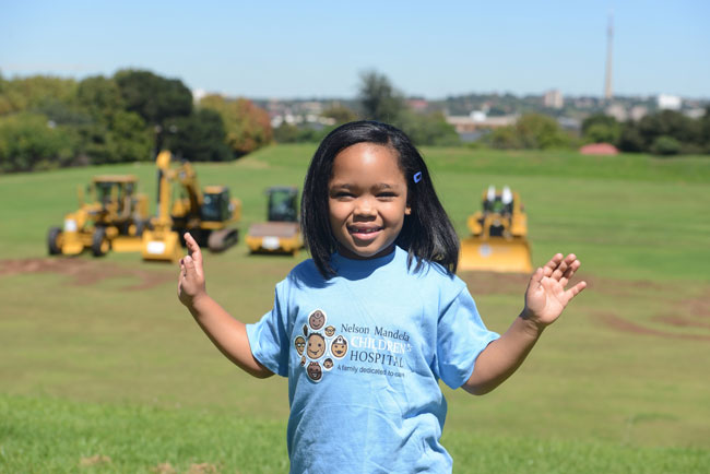 FILE PICTURE: Michai'ah Simons stands on the ground where the Nelson Mandela Children's Hospital will be built, 20 March 2014, Patktown.  Michai'ah became the face of the children's hospital when she sat on Nelson Mandela's lap in 2009 at his tree planting ceremony at the same location. Picture: Tracy Lee Stark