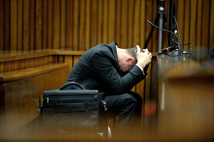 FILE PICTURE: Paralympian Oscar Pistorius is seen  at the North Gauteng High Court in Pretoria on the 6th day of his ongoing murder trial, Monday, 10 March 2014. The double amputee is accused of fatally shooting his girlfriend of few months Reeva Steenkamp at his home in the early hours of Valentines Day last year. Picture: Bongiwe Mchunu/Pool