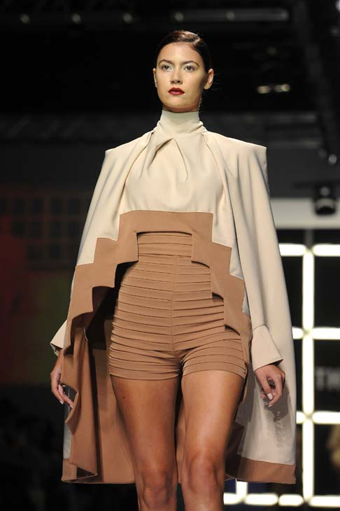 A model walks down the runway in a Ayanda Mthembu creation during David Tlale's The Intern show at the Mercedes-Benz Fashion Week Joburg held at the Sandton Convention Centre, 21 March 2014. Picture: Refilwe Modise