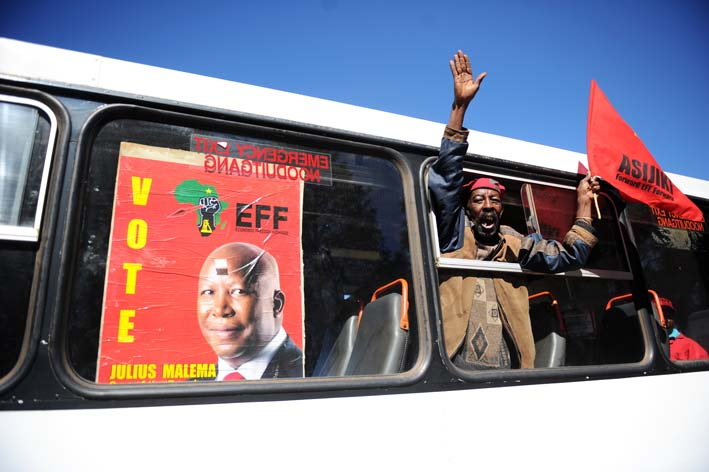 FILE PICTURE: Members and supporters of the Economic Freedom Fighters (EFF) march through the streets of Auckland Park, Johannesburg, to the SABC headquarters to protest the banning of their election campaign advert, 29 April 2014.  Picture: Michel Bega