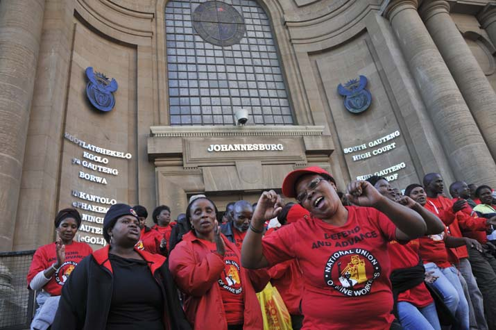 FILE PICTURE: National Union of Mineworkers sing, 29 April 2014, outside the South Gauteng High Court. Picture: Alaister Russell